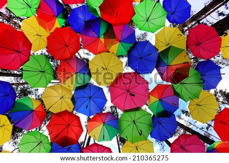Lots of colorful umbrellas in the sky - stock photo
