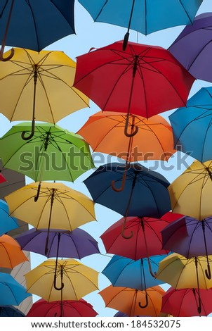 Lots of colorful umbrellas opposite opposite sky in the city of Belgrade,Serbia - stock photo