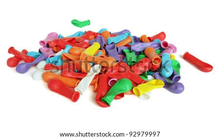 Lots of colorful water balloons on a white background. - stock photo