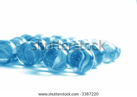 Lots of colourful glass marbles. Copyspace above - stock photo