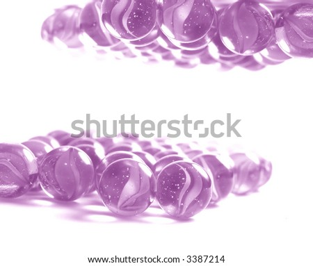 Lots of colourful glass marbles. The space for your product in the centre - stock photo