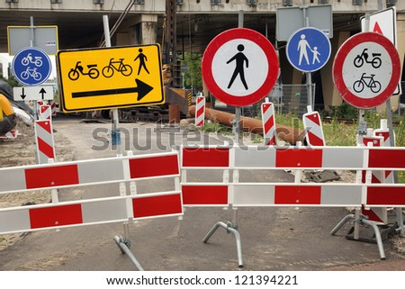 Lots of contradicting and colorful traffic signs - stock photo