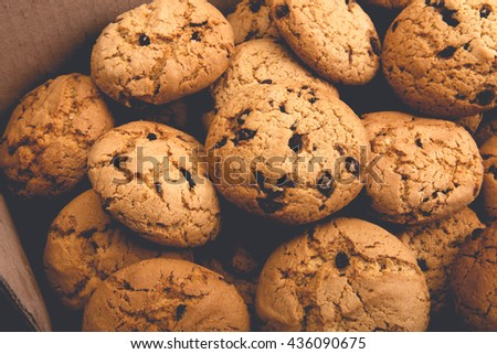 Lots of cookies and biscuits background. Sweet chocolate chips biscuits and cookies texture background. Oatmeal, chocolated drops and other sweets. Dessert, sweets for tea. Fattening sweets concept