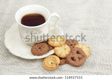 Lots of cookies on Food and Drink theme/Image of black tea cup with yummy biscuits - stock photo