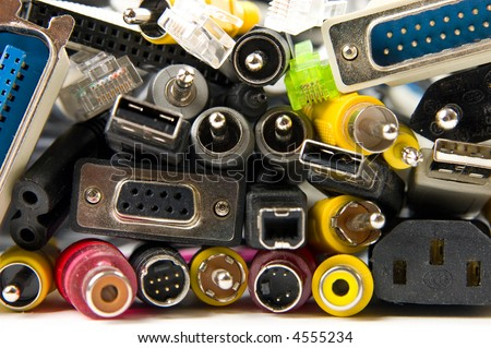 Lots of different electronic connectors and plugs - stock photo