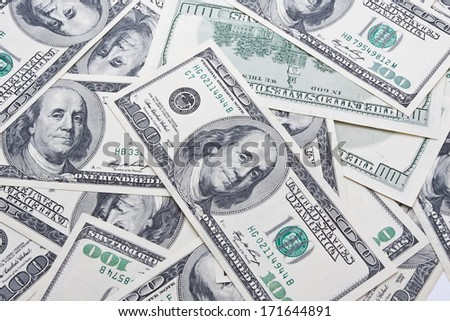 Lots of dollar notes arranged in chaotic manner, background