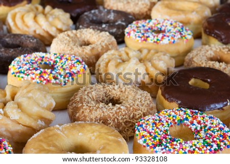 lots of donuts - side view - stock photo