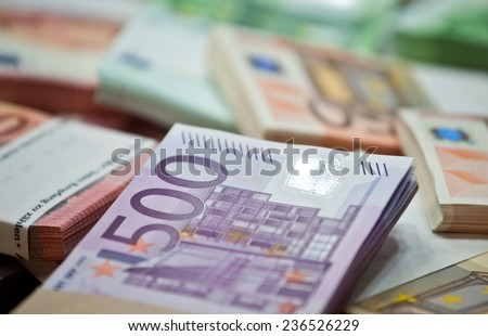 lots of euro bills on the table - stock photo