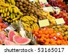 Lots of fruit on a stall at a market place - stock photo