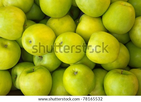 Lots of Green ripe apples background. - stock photo