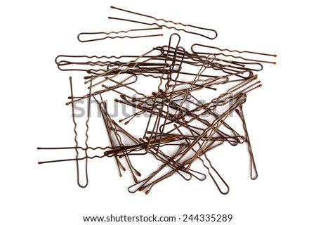 Lots of hairpins isolated on white - stock photo