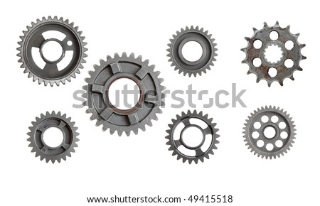 Lots of industrial metal gears isolated on a white background. - stock photo