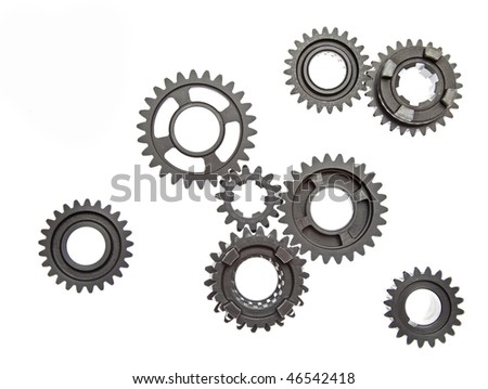 Lots of interesting metal gears on a white background. - stock photo