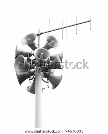 Lots of loudspeakers on a tall column - stock photo