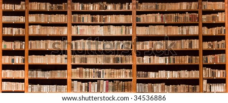 Lots of old books in a old library - stock photo