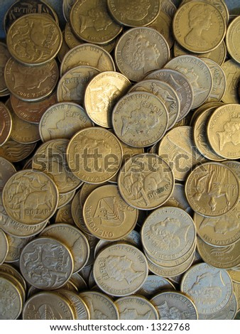 Lots of one dollar Australian coins. - stock photo