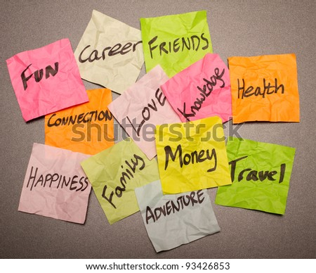 Lots of options on the table, time to sort through them - stock photo