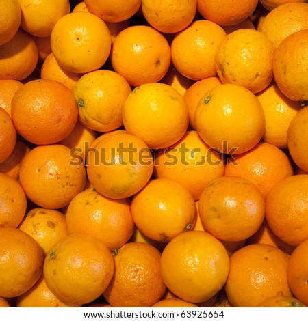 Lots of oranges forming an arrangement ideal for backgrounds and textures - stock photo