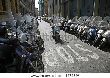 Lots of parked scooters and motorbikes in the center of Florence Italy. - stock photo