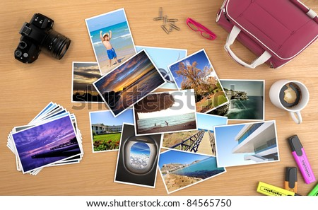 lots of photos spread on a desk with camera and other objects, images can be easily replaced with your own content. all pictures are made by me, some can be found on my portfolio. - stock photo