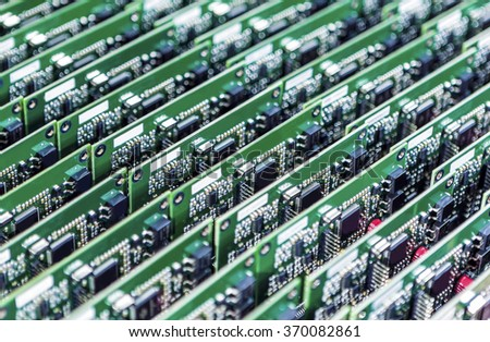 Lots of Printed Circuit Boards With Mounted and Soldered Componentry Arranged in Rows Together. Horizontal Image