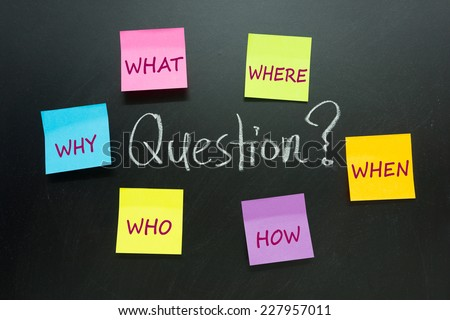 Lots of questions written on multicolor paper notes - stock photo