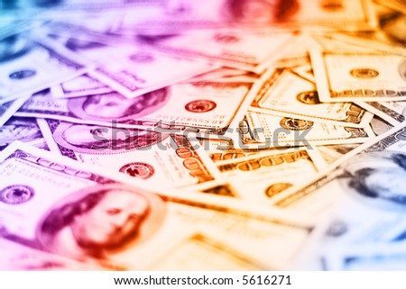 lots of real 100 colourful greenbacks for background (shallow dof) - stock photo