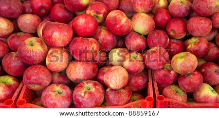 Lots of red ripe apples on the street market