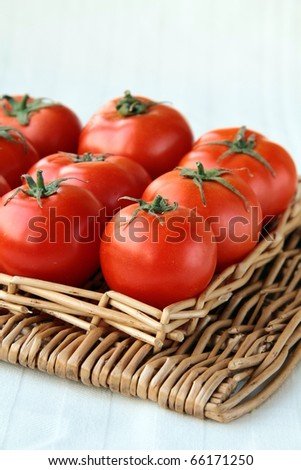 lots of ripe tomato on a wicker tray