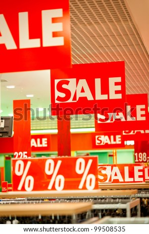 Lots of sale signs in clothing store - stock photo