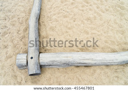 lots of sand with tree trunks as limiting - stock photo