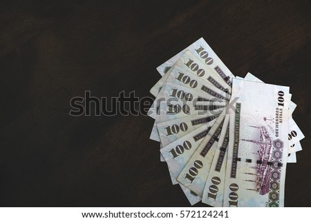 Lots of Saudi Arabia bank note over wooden background