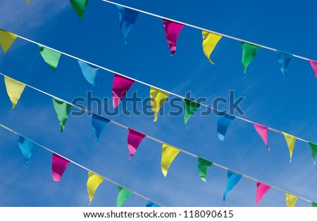 Lots of small color flags and blue sky. - stock photo