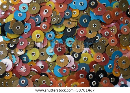 Lots of small grinding discs full frame view