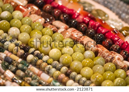 Lots of strings of beads made from natural stones