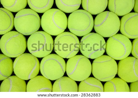 Lots of tennis balls for a background or pattern. - stock photo