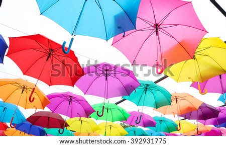 Lots of umbrellas coloring the sky in the city of Agueda, Portugal  background. - stock photo