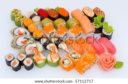 lots of various Japanese sushi and sushi rolls - stock photo