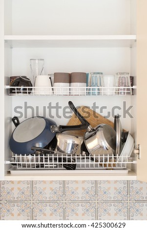 lots of wet dishes in the dish draining closet - stock photo