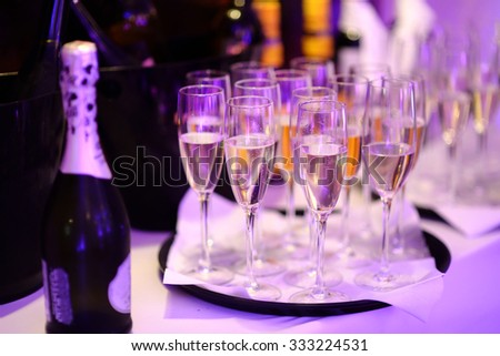 Lots of wine glasses during some festive event or wedding reception - stock photo