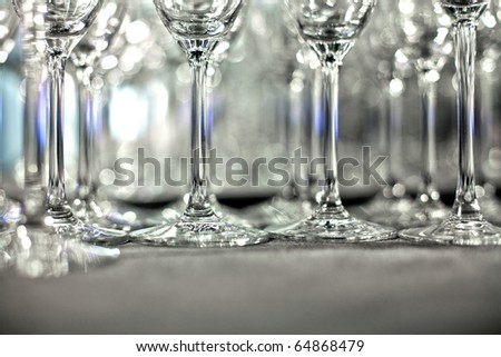 Lots of wine glasses on shelf - stock photo