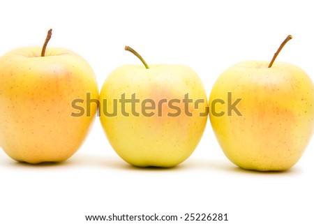 lots of yellow apples isolated on white