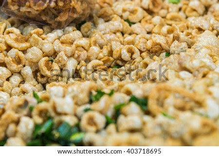Lots Pork rind with pandan leave snack of northern Thailand for sale with selective focus