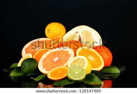 Lots ripe citrus isolated on black - stock photo