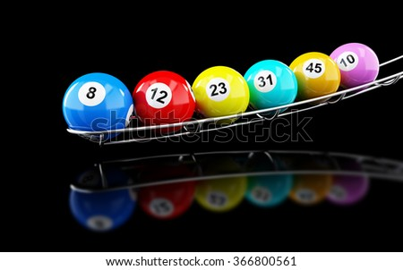 lottery balls on on a black background - stock photo