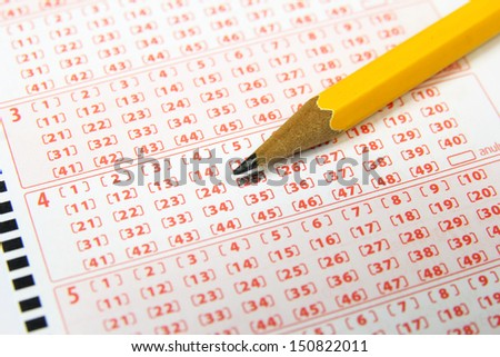 lottery ticket and pencil - stock photo