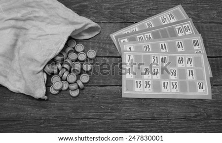 Lotto game cards and pieces in black&white colors - stock photo