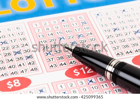 Lotto ticket gambling with pen, ticket is mock-up - stock photo