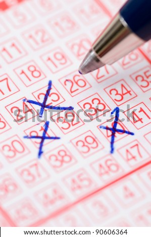 Lotto ticket with numbers - stock photo