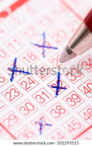 Lotto ticket with ticked numbers - stock photo